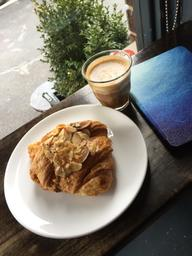 The Cortado was very bright and creamy, the almond croissant was absolutely delicious!   The music and vibes were super cozy! Perfect for a little date 🥰