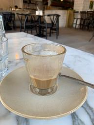 First time trying Oat milk in my Cortado. Very nice. Half empty drink photo.